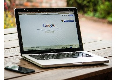 Picture of a laptop with the Google search page showing
